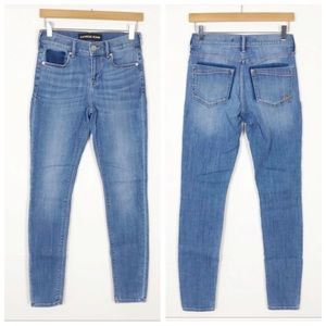 EXPRESS Mid Rise Light Wash Shadow Legging Jeans